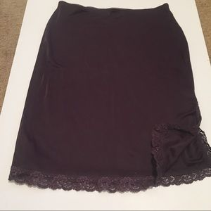 Slinky dark purple skirt with lace trim at hem